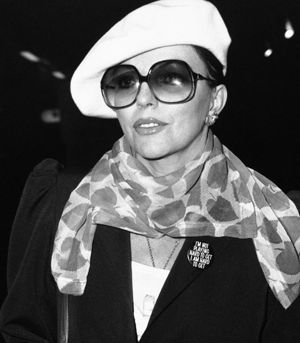 "Actress Joan Collins arrives at Heathrow from New York, April 11, 1983. She is part of the new British Airways advertising campaign and has just renewed her contract for the TV soap opera ""Dynasty."" She denied rumours that her contract would be earning her 50,000 dollars an episode. (AP Photo)"