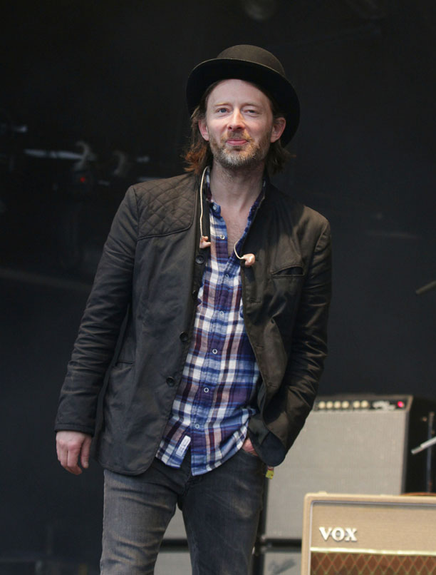 Thom Yorke of Radiohead dons the bowler hat to brave the rain showers of Glastonbury 2011. Fashion-forward Thom is, of course, no stranger to the wonders of the bowler hat. (Yui Mok/AP)