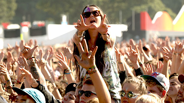 An ecstatic Bestival crowd (except for the people behind that girl), 2013 (Pic: Press Association via AP Images)