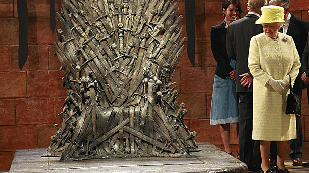 """Call that a throne?"" The Queen on the 'Game of Thrones' set (Pic: AP Photo/Peter Morrison)"
