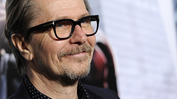 """Gary Oldman, a cast member in """"Robocop,"""" poses at the premiere of the film on Monday, Feb. 10, 2014, in Los Angeles. (Photo by Chris Pizzello/Invision/AP)"""