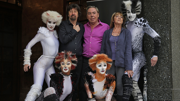 British composer Andrew Lloyd Webber, centre, director Trevor Nunn, left, and choreographer Gillian Lynne, right, pose for the photographers with performers in cat costumes, during a photo-op to promote the return of the musical Cats, in central London, Monday, July 7, 2014. The show, based on T.S Eliot's 'Old Possum's Book of Practical Cats', will return to the West End for a limited 12-week run from Dec, 2014. Cats, one of the longest-running shows in West End and on Broadway, received its world premiere in London in 1981 where it played for 21 record-breaking years and almost 9,000 performances. According to its creators Cats has been presented in over 26 countries, has been translated into 10 languages and has been seen by over 50 million people world-wide. (AP Photo/Lefteris Pitarakis)