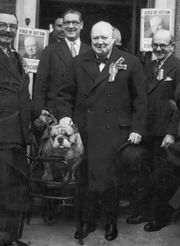 "FILE -- A Feb. 23, 1950 file photo of former British Prime Minister Winston Churchill with bulldog ""Barley Mow"" outside the Consevative Association in Essex. The Bulldog  which for some is seen as a potent symbol of the British nation's strength and pugnacity, will be deployed by the opposition Labour Party in a pre-election political broadcast Tuesday April 15, 1997 in a bid to wrest the patriotic high ground from the ruling Conservative Party. The broadcast will feature a ""British Bulldog"" as a meansof expressing Labour's message that Britain can do better under their rule in the build-up to the May 1 election. (AP Photo/File)"