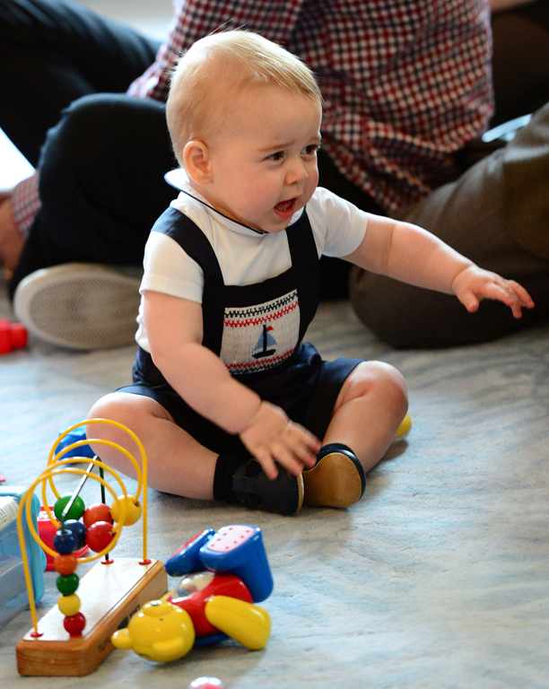 Prince George's first birthday. File photo dated 09/04/2014 of Prince George playing with toys as the Duke and Duchess of Cambridge and Prince George visit Plunket, a child welfare group at Government House, Wellington, during their official tour to New Zealand. Prince George first birthday is July 22. Issue date: Sunday July 13, 2014. See PA story ROYAL George Trendsetter. Photo credit should read: Anthony Devlin/PA Wire URN:20383144