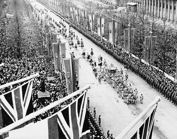 This picture taken from the top of Admiralty Arch shows the State Coach in which the King George VI and Queen  Elizabeth are riding down the mall enroute to the Westminster Abbey for coronation ceremonies on May 18, 1937 in London. (AP Photo)