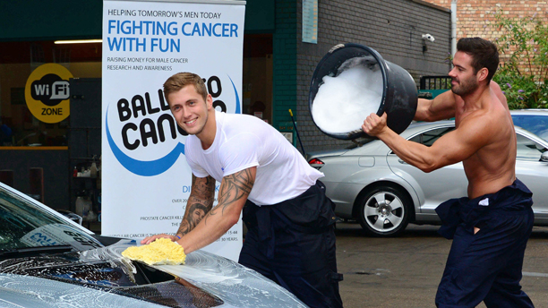 Dan Osborne has a bucket of water poured over him by a member of The Dreamboys Dan Osborne and The Dreamboys Balls to Charity car wash, London, Britain - 13 Aug 2014  (Rex Features via AP Images)