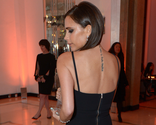 Victoria Beckham, winner of the Special Contribution to British Fashion Award poses for photographers during Harper's Bazaar Women of the Year Awards 2013 at Claridge's Hotel on Tuesday, Nov. 5, 2013, in London. (Photo by Jon Furniss/Invision for Harper's Bazaar/AP)