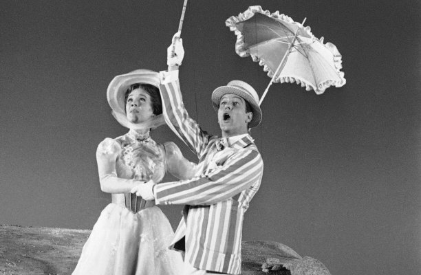 "Julie Andrews on the set of Mary Poppins with Dick van Dyke. The film used ""yellow screen"" composite technology to paint in elaborate backgrounds. (Don Brinn/AP)"