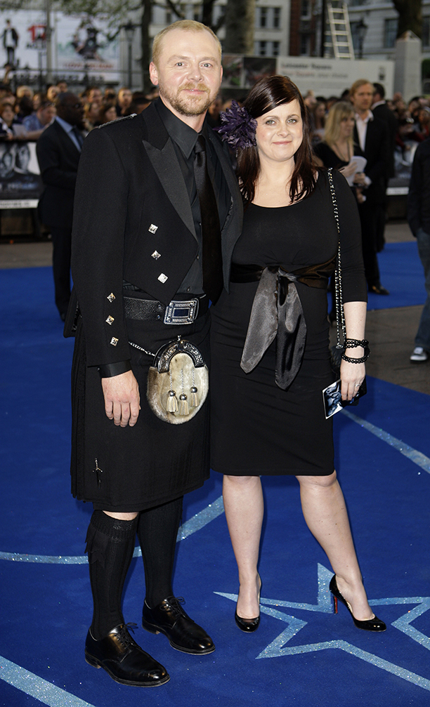 British actor Simon Pegg arrives with partner Maureen McCann for the UK Premiere of Star Trek at a Leicester Square cinema in London, Monday April 20, 2009.  (AP Photo/Joel Ryan)