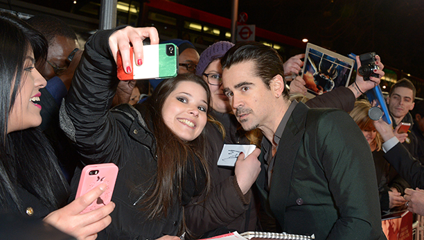 Irish actor Colin Farrell poses for pictures with fans as he arrives on the red carpet for A New York Winter's Tale UK Premiere on Thursday Feb. 13, 2014, in London. (photos by Jon Furniss/Invision/AP)