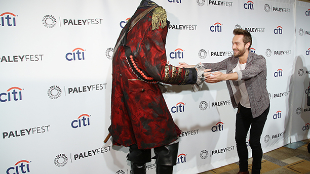 Tom Mison dances with his Sleepy Hollow co-star the Headless Horseman. (Photo by Annie I. Bang /Invision/AP)