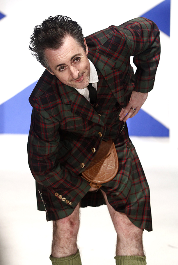 Actor Alan Cumming walks the runaway in the 8th annual Dressed To Kilt charity fashion show in New York, on Monday, April 5, 2010. (AP Photo/Peter Kramer)