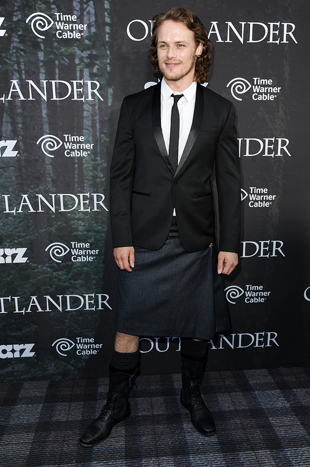 """Sam Heughan arrives at the 2014 Comic-Con - Starz """"Outlander"""" screening at the Spreckels Theater  on Day 2 of Comic-Con on Friday, July 25, 2014, in San Diego. (Photo by Richard Shotwell/Invision/AP)"""