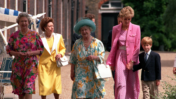 QUEEN ELIZABETH II, PRINCESS MARGARET, THE QUEEN MOTHER, PRINCE CHARLES & THE PRINCESS OF WALES(WEARING PINK POLKA DOT STYLE DRESS WITH PINK JACKET) HOLDING HANDS WITH PRINCE HARRY AS THEY CELEBARTE THE BIRTHDAY OF THE QUEEN MOTHER AT CLARENCE HOUSE - 92(Express Newspapers Via AP Images)