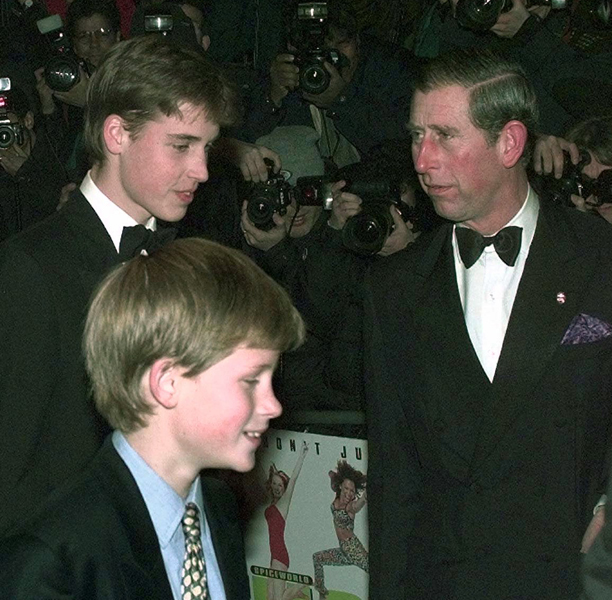 "Britain's Prince William, left, Prince Harry, center, and their father The Prince of Wales arrive at the Spice Girl movie ""Spice World"" premiere in London Monday Dec. 15, 1997. (AP Photo/ Max Nash)"