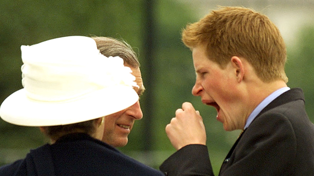 Britain's Prince Harry, right. attempts to stifle a yawn, watched by his father Prince Charles, and aunt, Princess Anne, outside Buckingham Palace in London Tuesday, June 4, 2002,  during celebrations marking The Golden Jubilee of Queen Elizabeth II. (AP Photo/Frank Barrett, pool)