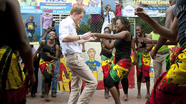 It's not all work, Prince Harry dances with Chantol Dorner during a visit to the Rise Life charity project , in Jamaica, as part of a Diamond Jubilee tour where he is a representing his grandmother, the Queen. Issue date: Wednesday December 19, 2012. See PA story XMAS Year. Photo credit should read: (John Stillwell/PA Wire)