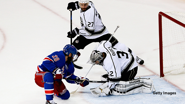 Hockey: Jonathan Quick #32 of the Los Angeles Kings with Dominic Moore #28 of the New York Rangers with Alec Martinez #27 of the Los Angeles Kings defending during the 2014 Stanley Cup finals. (Photo by Paul Bereswill/Getty Images)