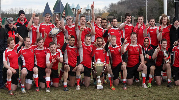The University of Wisconsin's RFC club with a hefty trophy.