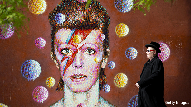 A man walks past a 3D wall portrait of British musician David Bowie, created by Australian street artist James Cochran, also known as Jimmy C, in Brixton, South London, on June 19, 2013. The artwork is based on the iconic cover for Bowies 1973 album, Aladdin Sane. AFP PHOTO/JUSTIN TALLIS        (Photo credit should read JUSTIN TALLIS/AFP/Getty Images)