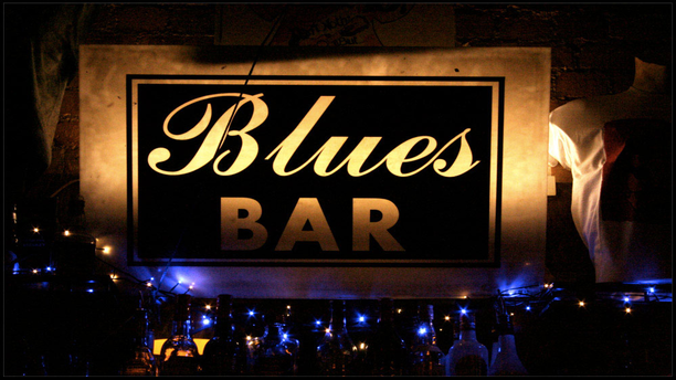 "Ain't Nothin' But's ""Blues Bar"" sign inside the pub."