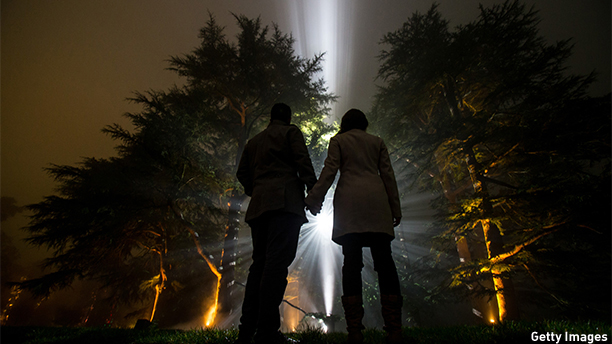 TETBURY, ENGLAND - NOVEMBER 26:  People look at trees that are illuminated at a preview for this year's Enchanted Christmas at the Forestry Commission's National Arboretum at Westonbirt near Tetbury on November 26, 2014 in Gloucestershire, England. Enchanted Christmas is Westonbirt's signature winter event, aimed at inspiring festive cheer with its one mile stretch of beautifully lit trees and interactive light and sound exhibits. The event takes place at the arboretum every Friday, Saturday and Sunday evening from Friday 29 November to Sunday 22 December.  (Photo by Matt Cardy/Getty Images)