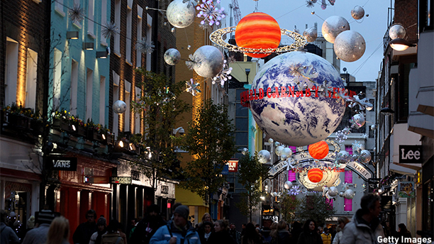 LONDON, ENGLAND - NOVEMBER 29:  Space-themed Christmas lights hang over Carnaby Street on November 29, 2010 in London, England. Despite the global economic downturn and cold weather, high street retailers have generally been experiencing good Christmas trading which has been attributed in part to January's rise in VAT from 17.5% to 20%.  (Photo by Oli Scarff/Getty Images)