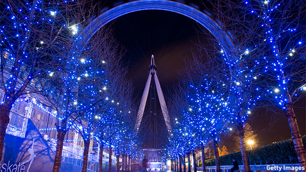 Christmas decorations in the trees light up the path leading towards the London Eye in central London on December 14, 2012.  Areas of central london are illumainated with Christmas lighting as the British capital gears up for the festive season.  AFP PHOTO/Leon Neal        (Photo credit should read LEON NEAL/AFP/Getty Images)