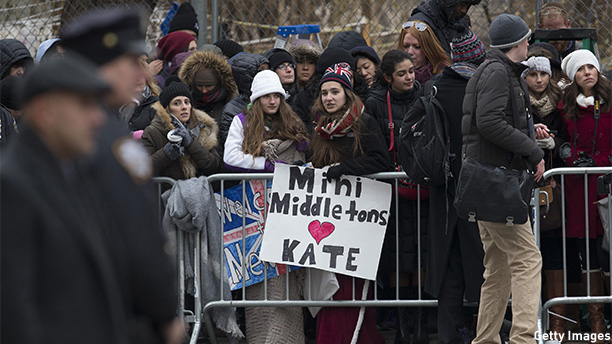 NEW YORK, NY - DECEMBER 08: Fans wait to see Catherine, Duchess of Cambridge, as she arrives at Northside Center for Child Development on December 8, 2014 in New York City. The royal couple are on an official three-day visit to New York with Prince William also due to meet President Barack Obama in Washington D.C on Monday. (Photo by Carl Court/Getty Images)