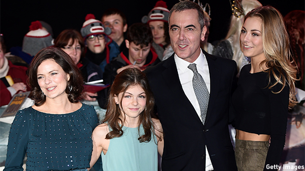 "Northern Irish actor James Nesbitt poses for pictures on the red carpet with his wife Sonia Forbes-Adam and daughters Peggy (R) and Mary (2nd L) upon arrival for the world premier of ""The Hobbit: The Battle of the Five Armies"" in central London on December 1, 2014. AFP PHOTO/LEON NEAL        (Photo credit should read LEON NEAL/AFP/Getty Images)"