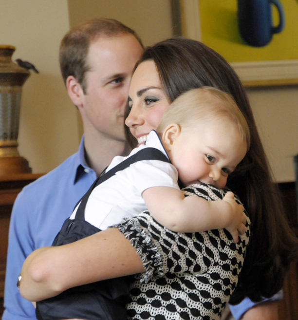Prince George gives his mum a cuddle. (PA Wire)