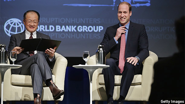 """WASHINGTON, DC - DECEMBER 08:  Prince William, Duke of Cambridge (R) and World Bank President Jim Kim participate in the International Corruption Hunters Alliance Conference at the World Bank during an official three-day visit to the United States December 8, 2014 in Washington, DC. After meeting with President Barack Obama earlier in the day, the duke addressed the conference, calling the trade in elephants tusks, rhino horns and other animal parts as """"one of the most insidious forms of corruption and criminality in the world today.""""  (Photo by Chip Somodevilla/Getty Images)"""