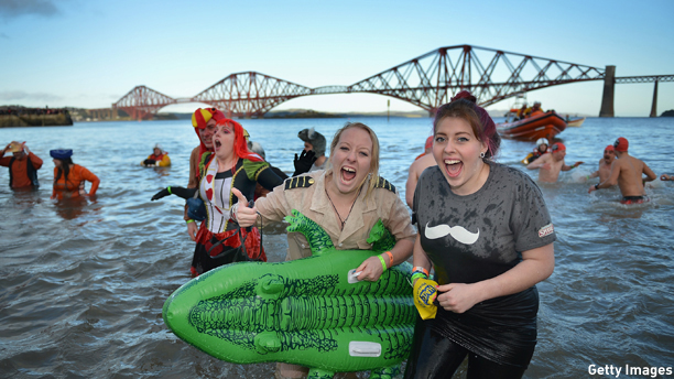SOUTH QUEENSFERRY, SCOTLAND - JANUARY 01:  Over 1000 New Year swimmers, many in costume, brave the freezing conditions in the River Forth in front of the Forth Rail Bridge during the annual Loony Dook Swim on January 1, 2013 in South Queensferry, Scotland. Thousands of people gathered last night to see in the New Year at Hogmanay celebrations in towns and cities across Scotland.  (Photo by Jeff J Mitchell/Getty Images)
