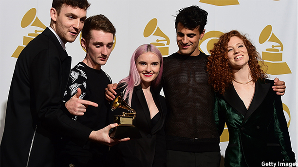 "Clean Bandit hold their Grammy for Best Dance Recording, ""Rather Be,""  in the press room during the 57th annual Grammy Awards in Los Angeles, California on February 8, 2015. From left are:  Jack Patterson, Luke Patterson, Grace Chatto, Milan Neil Amin-Smith, and Jess Glynne.   AFP PHOTO / FREDERIC J(FREDERIC J. BROWN/AFP/Getty Images)"