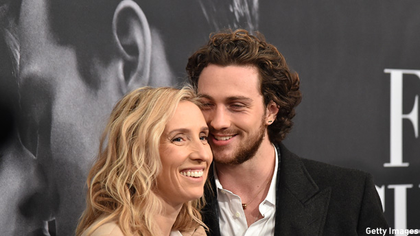 "NEW YORK, NY - FEBRUARY 06:  Director Sam Taylor-Johnson (L) and actor Aaron Taylor-Johnson attend the ""Fifty Shades Of Grey"" New York Fan First screening at Ziegfeld Theatre on February 6, 2015 in New York City.  (Photo by Mike Coppola/Getty Images)"