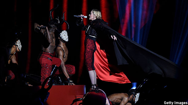 Madonna, a cape, and a bunch of dancers with horns. What could go wrong? (Pic: Gareth Cattermole/Getty Images)