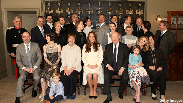 LONDON, ENGLAND - MARCH 12:  Catherine, Duchess of Cambridge (C) poses with cast, crew and producers of Downton Abbey during an official visit to the set of Downton Abbey at Ealing Studios on March 12, 2015 in London, England.  (Photo by Chris Jackson - WPA Pool/Getty Images)