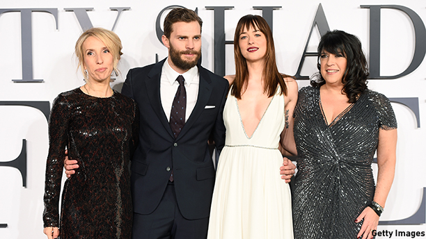"LONDON, ENGLAND - FEBRUARY 12:  (L-R) Director Sam Taylor-Johnson, actors Jamie Dornan, Dakota Johnson and author E.L. James attend the UK Premiere of ""Fifty Shades Of Grey"" at Odeon Leicester Square on February 12, 2015 in London, England.  (Photo by Ian Gavan/Getty Images)"