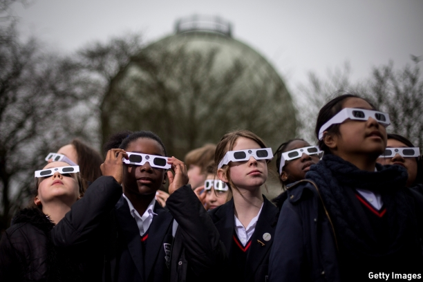 These schoolchildren wait patiently - and with safety glasses - for a glimpse through the clouds at the Greenwich Observatory in London. (Pic: Rob Stothard/Getty Images)