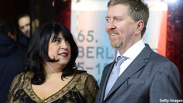 British writer E L James (L) and her Irish-born husband Niall Leonard walk on the red carpet as they arrive for the screening of Fifty 'Shades of Grey' as part of Berlinale Special Gala at the 65th Berlin International Film Festival Berlinale in Berlin, on February 11, 2015.     AFP PHOTO / JOHN MACDOUGALL        (Photo credit should read JOHN MACDOUGALL/AFP/Getty Images)