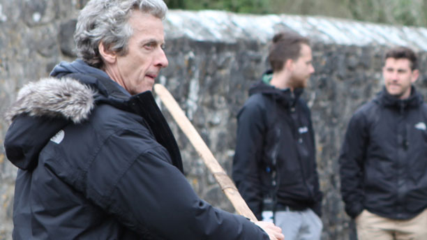 Peter Capaldi buckling his swash during filming for 'Doctor Who' Season Nine (Pic: BBC)