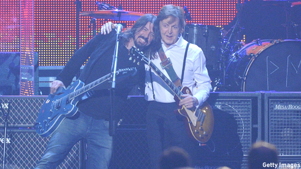 LOS ANGELES, CA - FEBRUARY 10:  Musicians Dave Grohl (L) and Sir Paul McCartney perform onstage at the 2012 MusiCares Person of the Year Tribute to Paul McCartney held at the Los Angeles Convention Center on February 10, 2012 in Los Angeles, California. (Photo by Jason Merritt/Getty Images)
