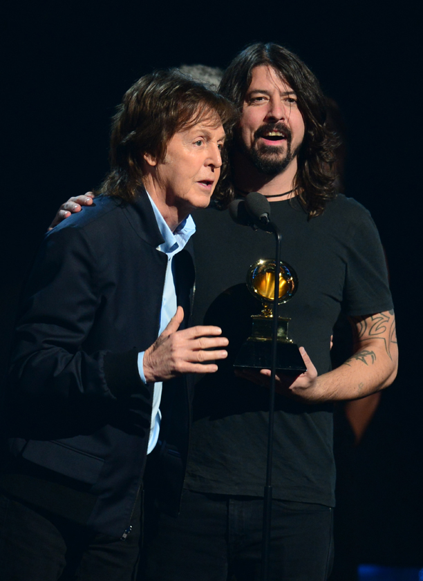 Winners For Best Rock Song Paul McCartney (L) and Dave Grohl (with Krist Novoselic and Pat Smear) give their acceptance speech on stage during the 56th Grammy Awards at the Staples Center in Los Angeles, California, January 26, 2014. AFP PHOTO FREDERIC J. BROWN        (Photo credit should read FREDERIC J. BROWN/AFP/Getty Images)