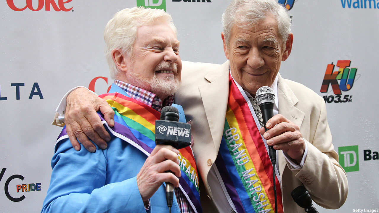 Sirs Derek Jacobi and Ian McKellen huddle up prior to the start of the 2015 NYC Pride Parade. (Neilson Barnard/Getty Images)
