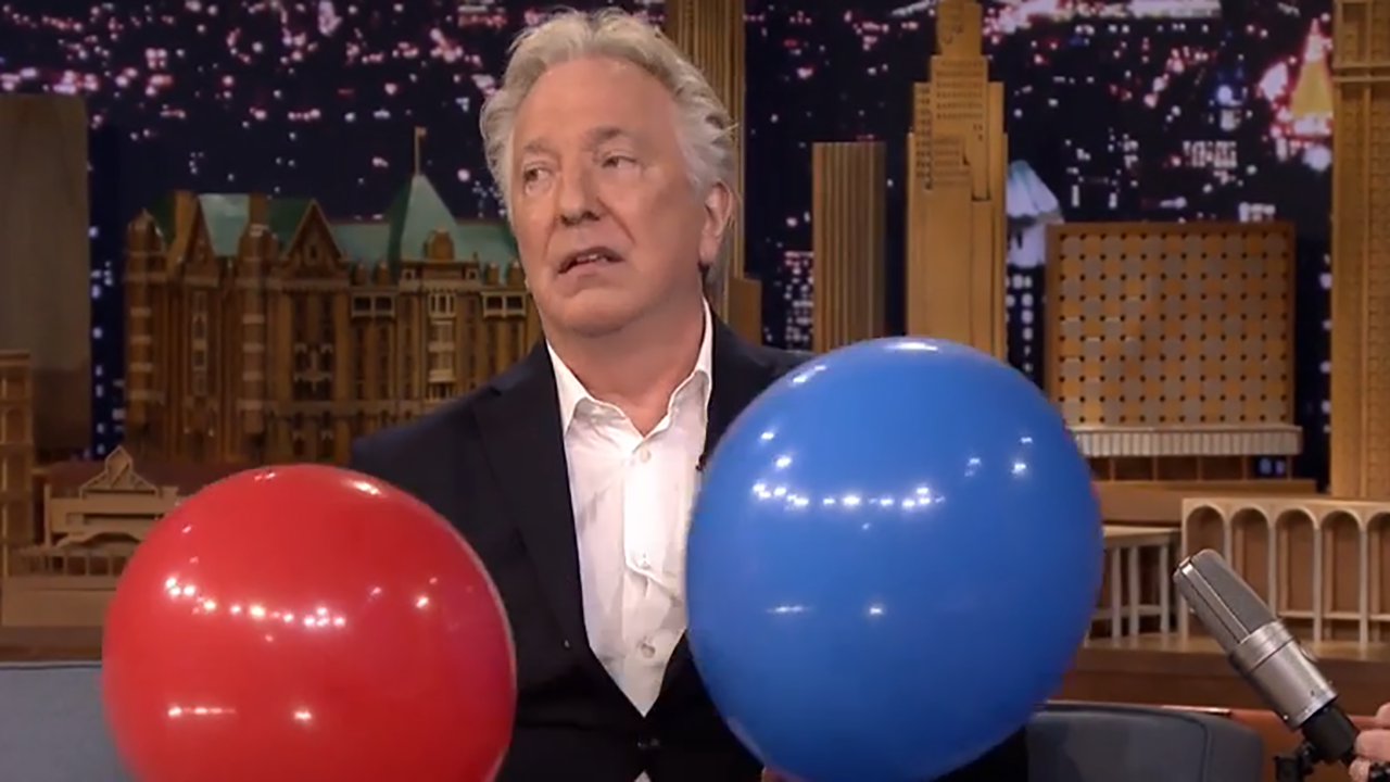 "Alan Rickman looks less than enthused but he's ""acting."" (YouTube)"
