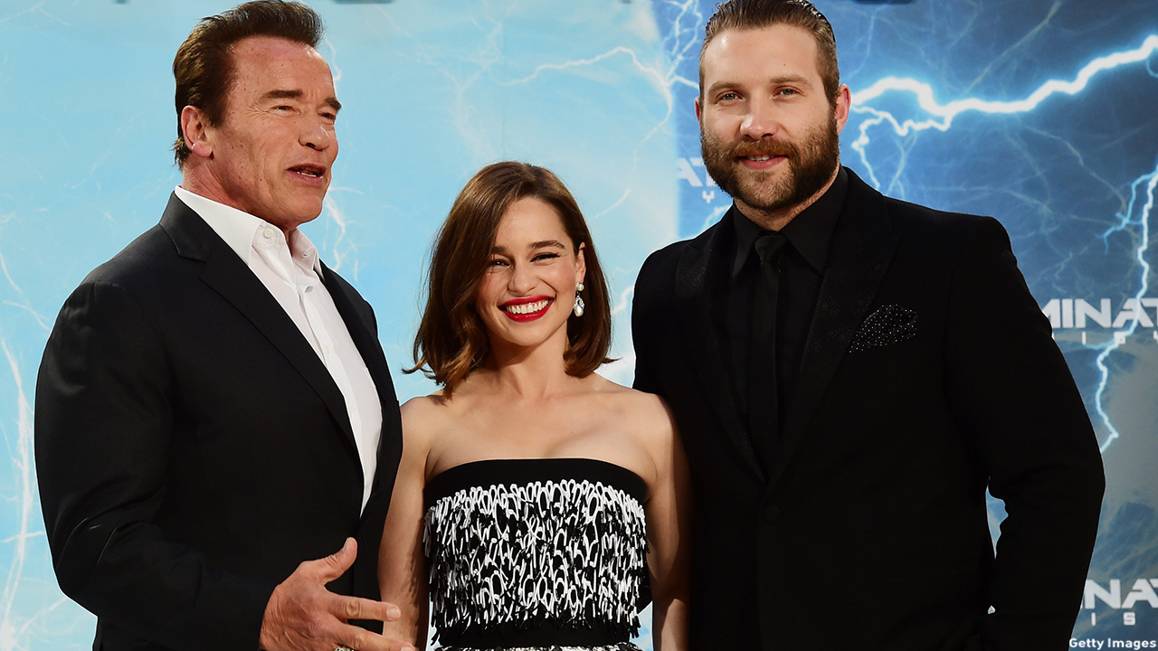 Emilia Clarke is joined by Terminator Genisys co-stars Arnold Schwarzenegger and Jai Courtney at the film's premiere in Berlin, Germany on June 21, 2015. (John MacDougall/Getty Images)
