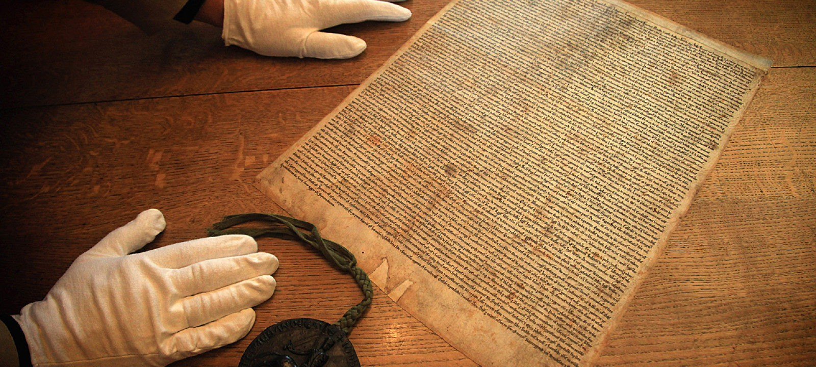 A facsimilie copy of the 1215 Magna Carta (Pic: Matt Cardy/Getty Images)