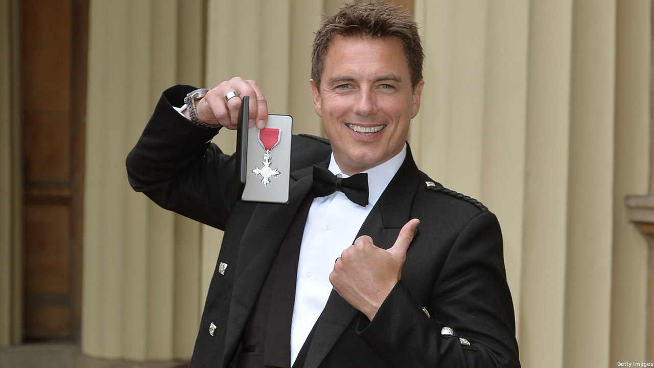 John Barrowman and his MBE (Pic: WPA Pool/Getty Images)