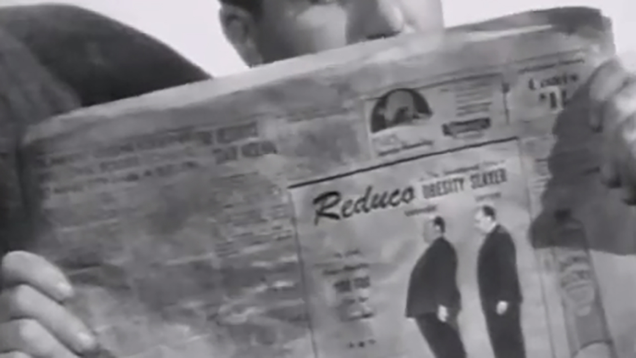 Alfred Hitchcock drew himself into the 1944 film Lifeboat. (YouTube)