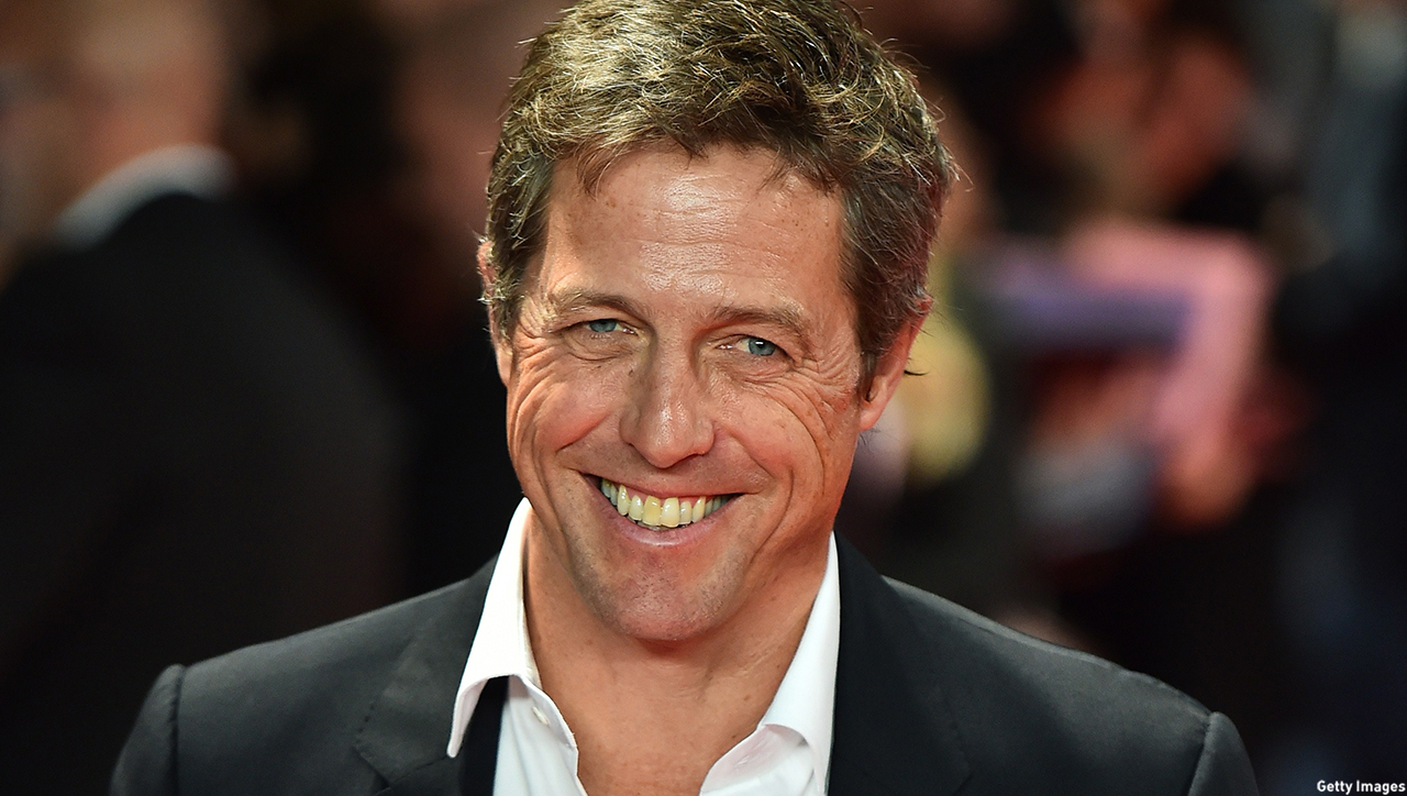 "British actor Hugh Grant poses for pictures on the red carpet as he arrives to attend the European premier of his latest film ""The Rewrite"" in London on October 7, 2014. AFP PHOTO/BEN STANSALL        (Photo credit should read BEN STANSALL/AFP/Getty Images)"